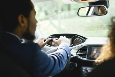 Businessman driving car - EBSF001147