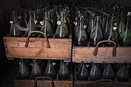 Germany, Burghausen, old wooden beer crates with empty beer bottles at Raitenhaslach Abbey - HAMF000102