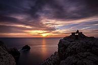 Spain, Balearic Islands, Menorca, Punta Nati, Watching the sunset, viewout - SMA000398