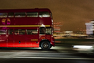 UK, London, driving double-decker bus at night - MAU000072