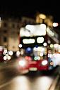 UK, London, defocused double-decker bus at night - MAU000081