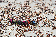 Scattered mixture of quinoa and cubes building the word 'quinoa' - MYF001244