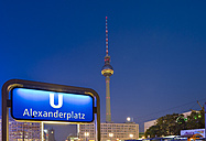 Germany, Berlin, view to television tower with underground sign in the foreground - RJ000542