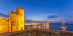 Greece, Rhodes, old town with view to Mandraki harbour at blue hour - WDF003390