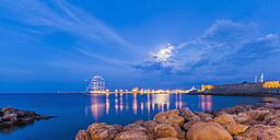 Greece, Rhodes, harbor, city wall and saiing ship at dusk - WDF003399
