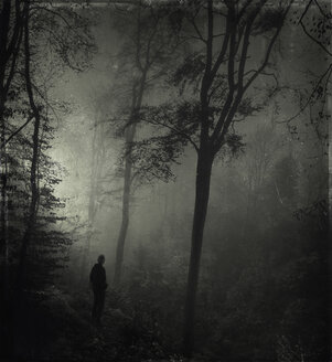 Man standing in gloomy forest - DWI000651