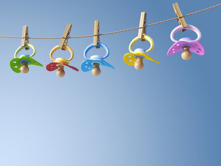 Five pacifiers hanging on a washing line, 3D Rendering - AHUF000077