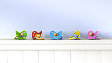 Row of different pacifiers on a shelf, 3D Rendering - AHUF000080