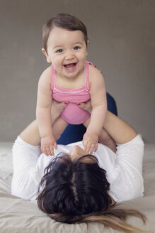 Portrait of happy baby girl holding by her mother - LITF000005