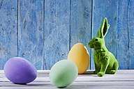 Easter decoration with green Easter bunny and three eggs - CSF026752