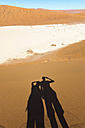Namibia, Namib Desert, shadow of couple looking to Deadvlei - GEMF000508