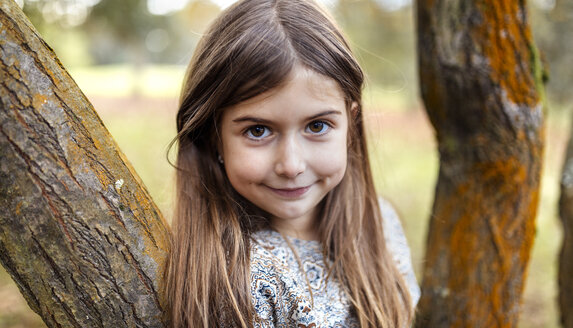 Portrait of smiling girl in nature - MGOF001115