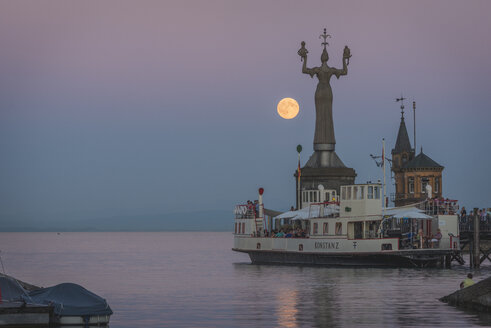 Germany, Constance, Harbour entrance with Imperia statue and full moon - KEB000290