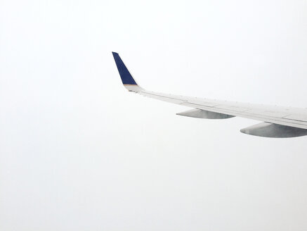 airplane wing in front of white sky - BMA000081