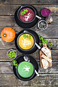 Pea soup, beetroot and pumpkin soup in bowls - SARF002378