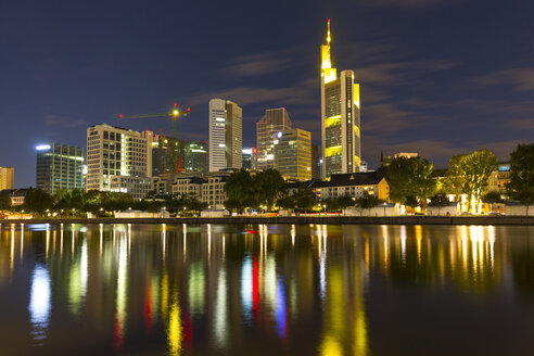 Germany, Frankfurt, River Main at night, Skyline of finanial district in background - MABF000350