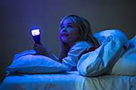 Little girl with a torch in bed - JFEF000757