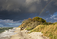 Germany, Mecklenburg-Western Pomerania, rain clouds and rainbow over Baltic Sea beach in Born auf dem Darss - SIEF006883