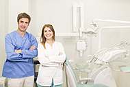 Portrait of two confident dentists in surgery - JASF000289