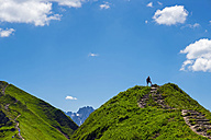 Austria, Tyrol, Allgaeu Alps, Hiker standing at Fellhorn mountain - WGF000782