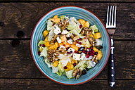 Autumnal salad with kaki, feta cheese, iceberg lettuce, pumpkin seeds, pomegranate and walnuts - SARF002390