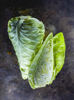 Whole and half of sweetheart cabbage on dark ground - KSWF001706