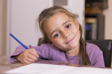 Portrait of smiling little girl with blue pencil - ERLF000086