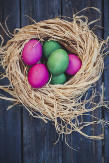 Green and pink Easter eggs in nest - SBDF002542