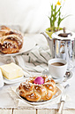 Braided Easter bread with pink egg, daffodil, coffee and butter - SBDF002551