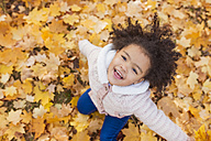 Little girl playing in autumn park - HAPF000010