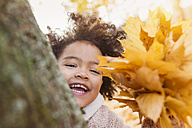 Little girl playing in autumn park - HAPF000013