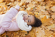 Little girl playing in autumn park - HAPF000025