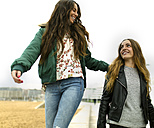 Two happy female friends outdoors - MGOF001140