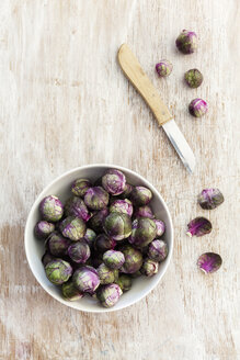 Red brussels sprouts in bowl, knife - EVGF002538