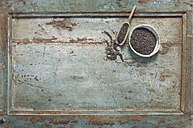 Chia seeds in bowl, shovel on wood - ASF005786