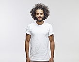 Portrait of bearded young man with curly brown hair wearing white t-shirt - RHF001092