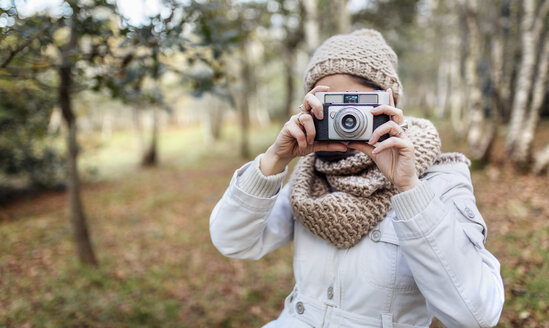 Woman taking a picture in the forest - MGOF001172