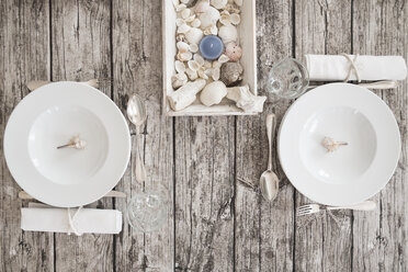 Two place settings on maritime laid table - LVF004301
