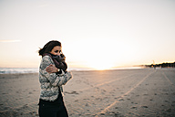 Young woman freezing on the beach in winter - JRFF000243