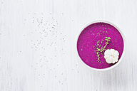 Bowl of dragon fruit smoothie on light ground - KNTF000207