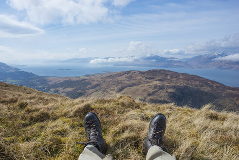UK, Scotland, Scottish Highlands, Glencoe, resting hiker on top of a mountain - JBF000251