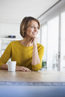 Relaxed woman at home with cup of coffee - RBF003619