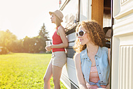 Two female friends at holiday with caravan - HAPF000053