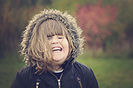 Portrait of girl laughing, winter jacket - MJOF001127