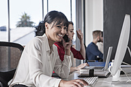 Woman in office talking on the phone - ZEF007498