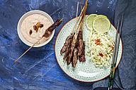 Beef skewers and bowl of Sambal Kacang - SBDF002593