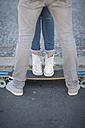 Young couple with skateboard on the street - ZEF007610
