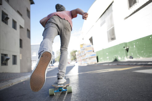 Rear view of a skateboarder on the street - ZEF007613