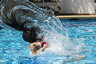 Woman in the pool water with hair pulling - SKCF000034