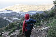 Spain, Catalunya, Girona, female hiker in the nature looking at view - EBSF001163